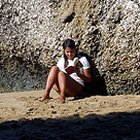 girl reading on rock